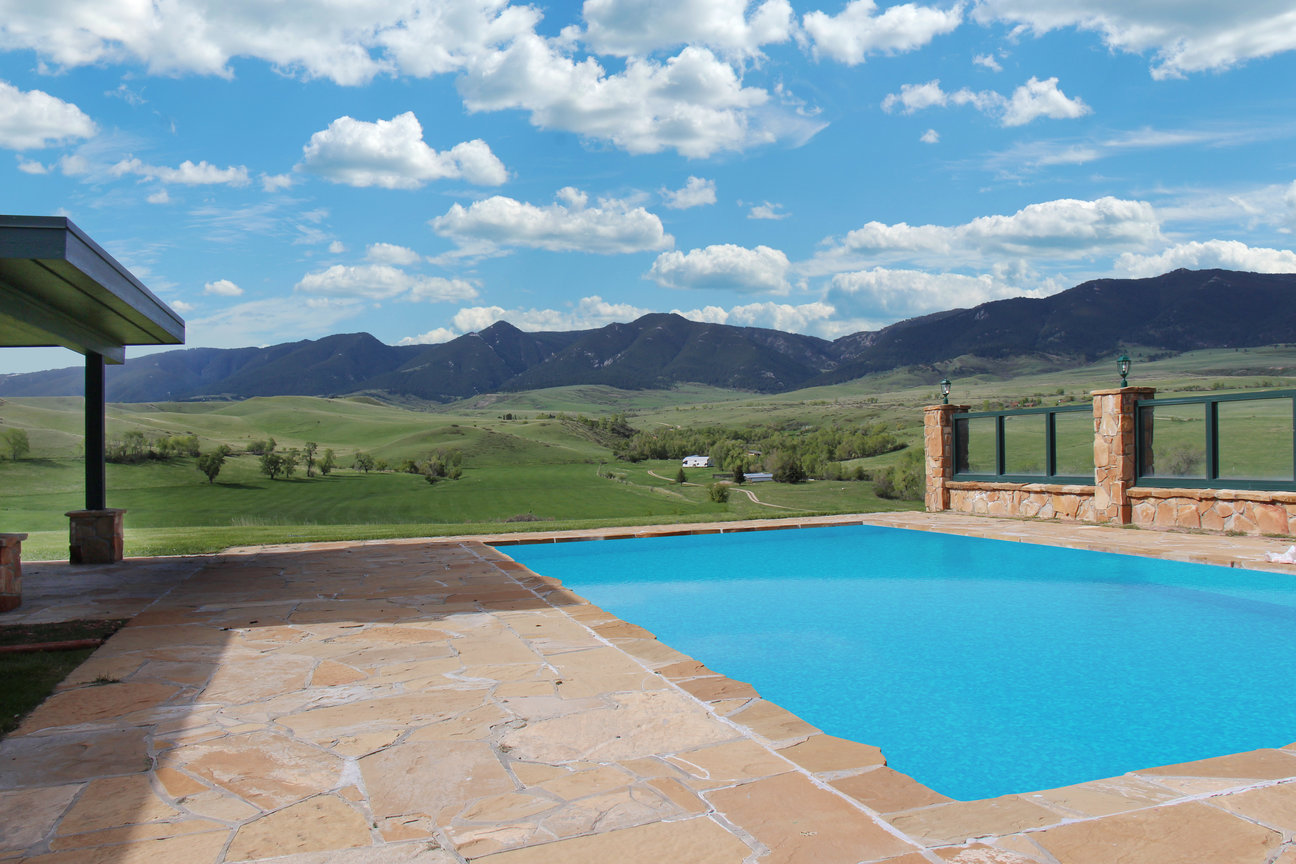 pool and poolhouse with stunning views at holy how ranch